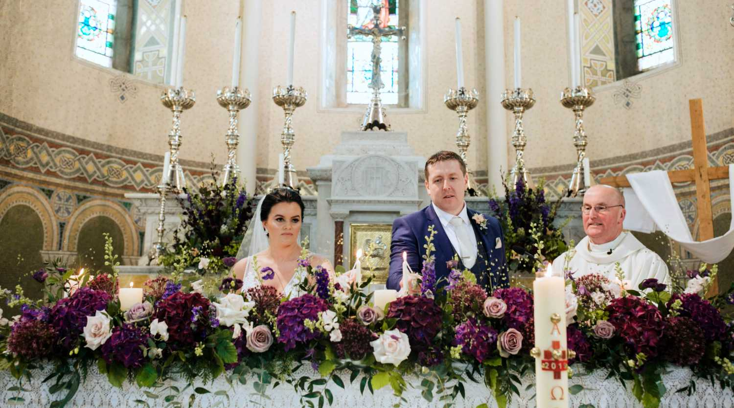 Purple and White Floral Display on Church Altar