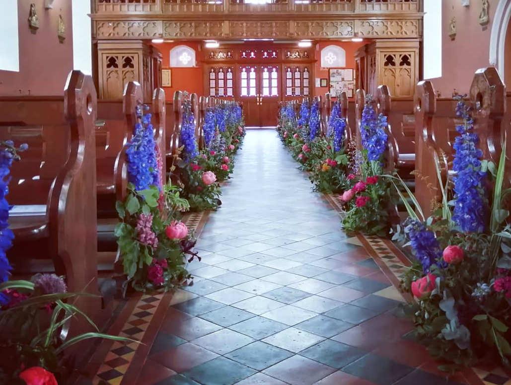 Blue Wedding Flowers Decorating Church Pews