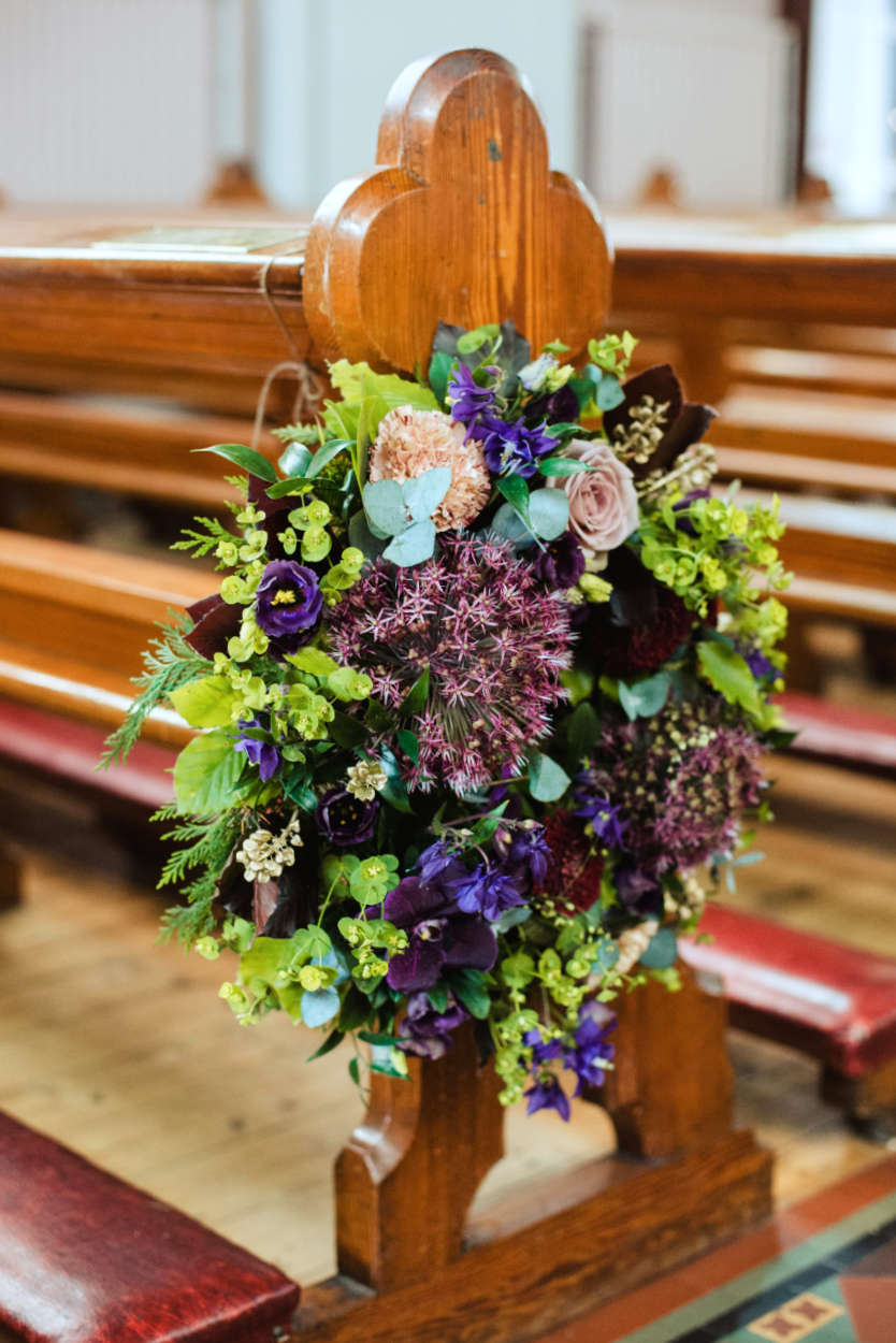 Colourful Wedding Flowers on Church Pew