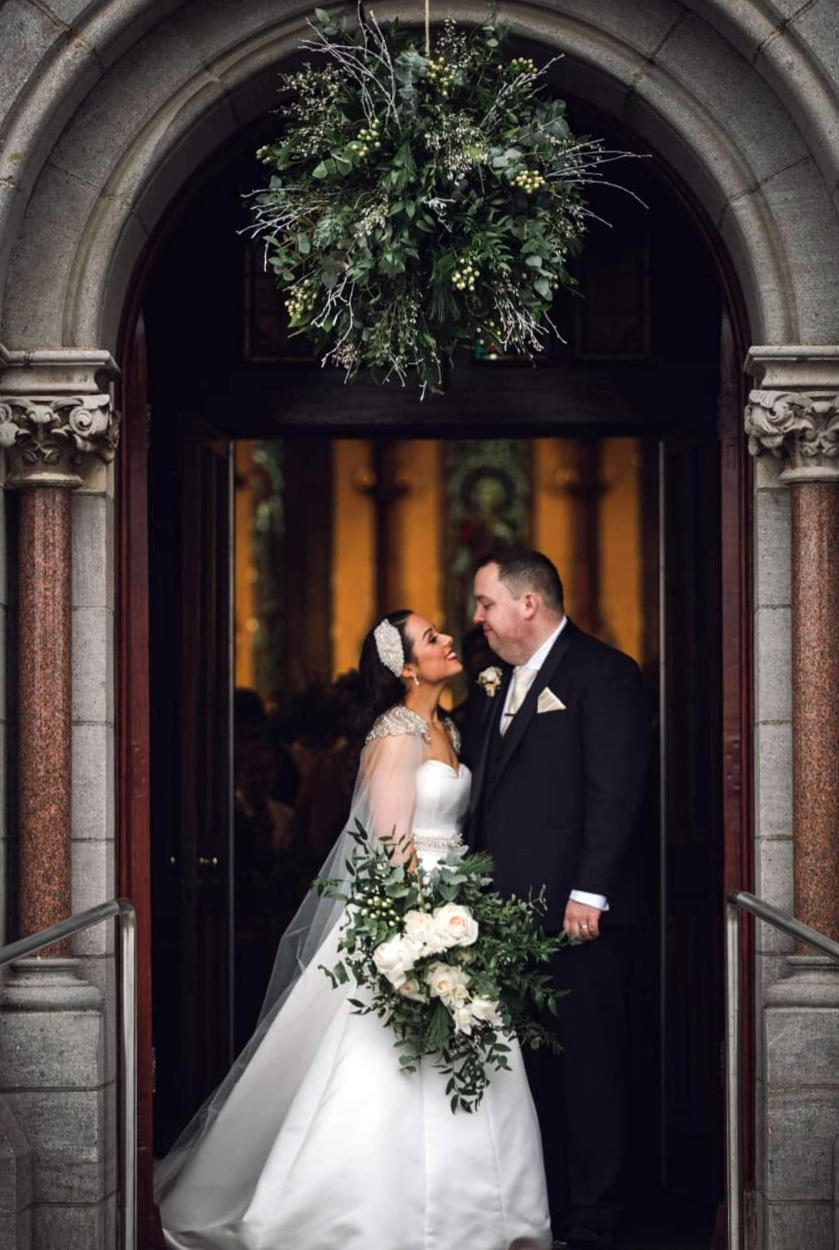 Floral Kissing Ball Hanging in Church Doorway