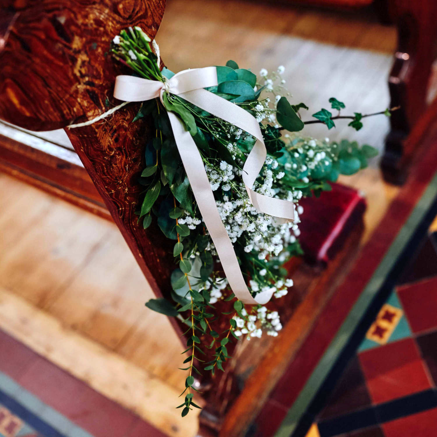White Flower Bouquet Hanging on Church Pew