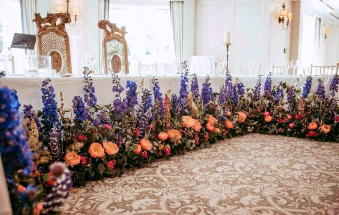 Floral Decoration around Head Wedding Table
