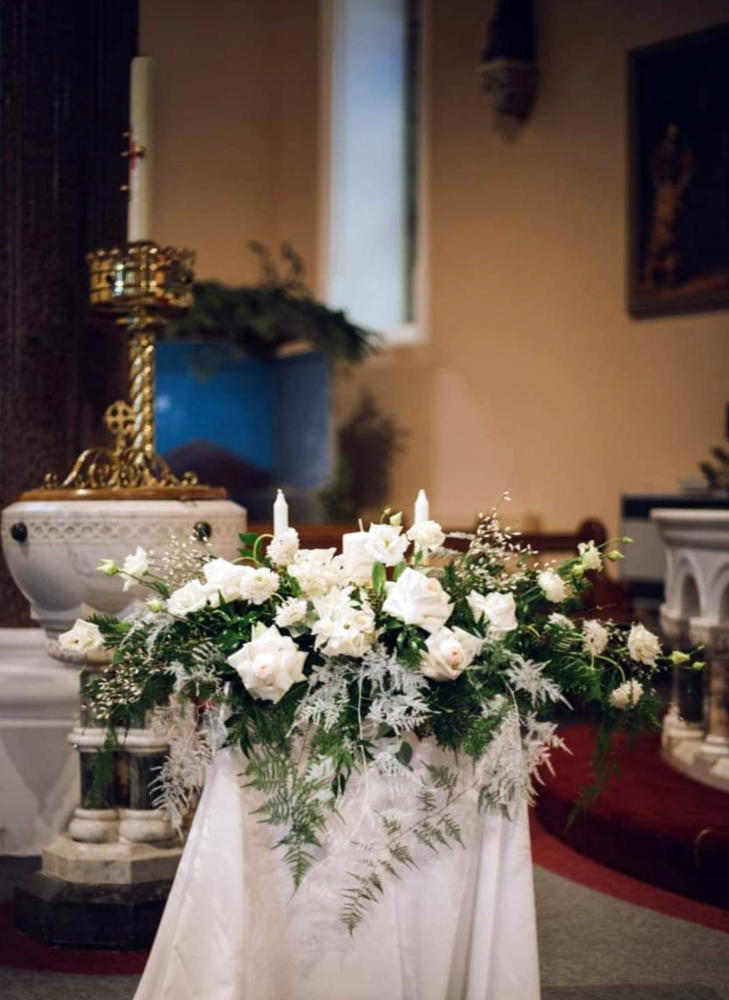 White Roses on a Church Pedestal