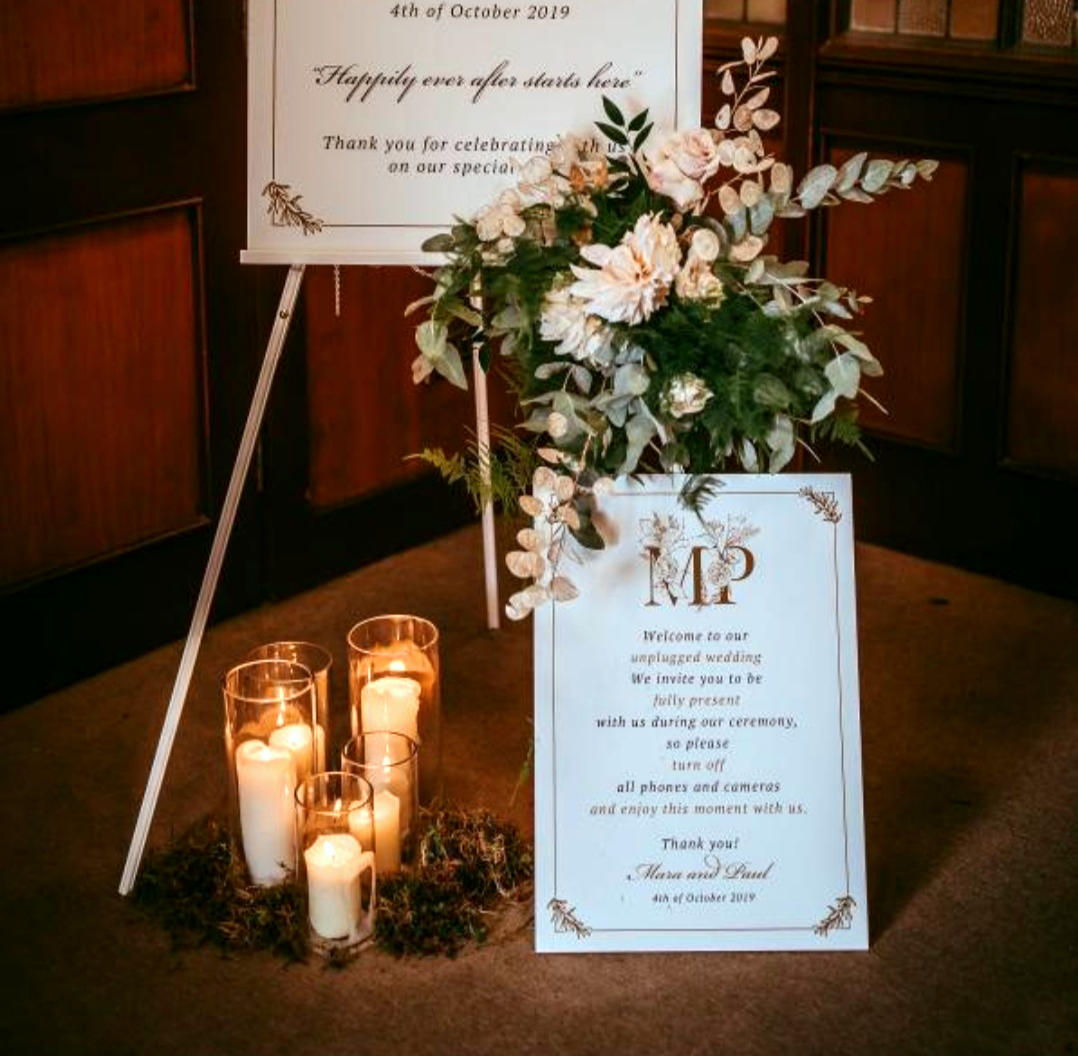 White Wedding Flowers at Venue Entrance